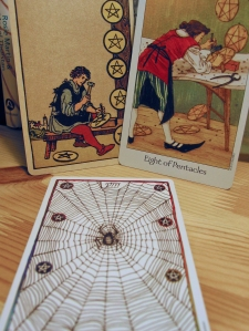 Eight of Pentacles. Smith-Waite Centennial Deck, Dreaming Way Tarot, Wild Unknown Tarot