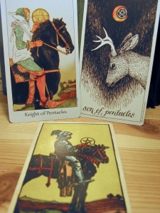 Knight of Pentacles. Dreaming Way Tarot, Wild Unknown Tarot, Smith-Waite Centennial Deck.