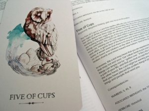 Five of Cups card with description. The cards are 2 3/4