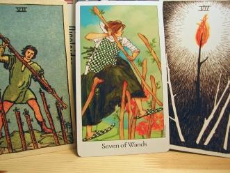Seven of Wands. Smith-Waite Centennial Deck, Dreaming Way Tarot, Wild Unknown Tarot