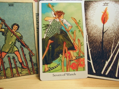 Seven of Wands. Smith-Waite Centennial Deck, Dreaming Way Tarot, Wild Unknown Tarot