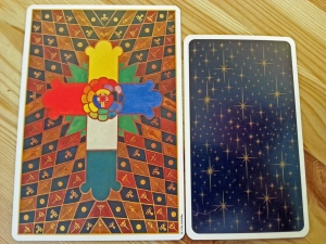 The Thoth tarot beside the Universal Waite tarot for size comparison.